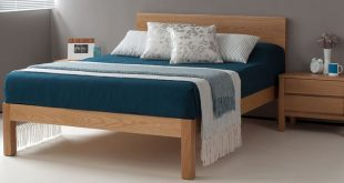 The Tibet bed in solid oak (dressed with bedding exclusive to Natural Bed Compan...