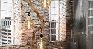Floor lamp of 294 cm high on boulder including lampshades