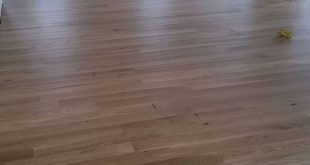 white oak floors, sanded, sealed, sanded 3x, then matte top coat Bona Finish. No...